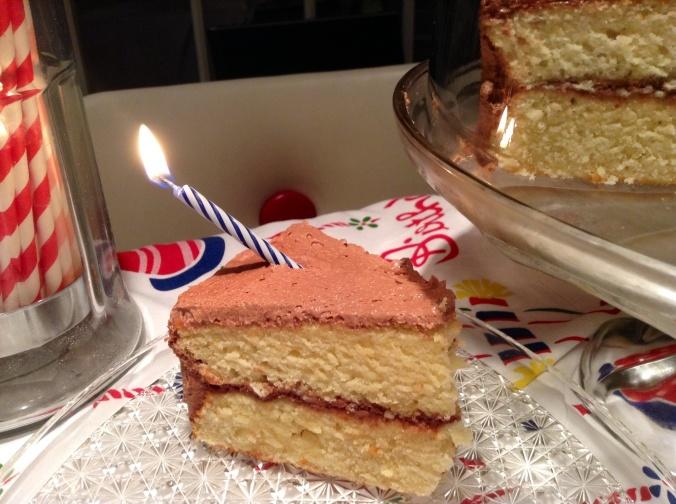 Vanilla cake with chocolate, cream cheese frosting